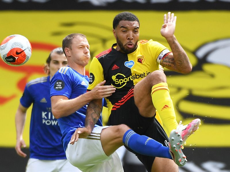 Watford's Troy Deeney fights with Leicester City's Jonny Evans.