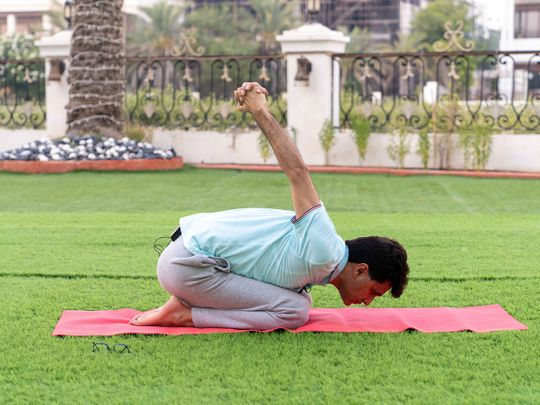 Anis Sajan in a yoga pose