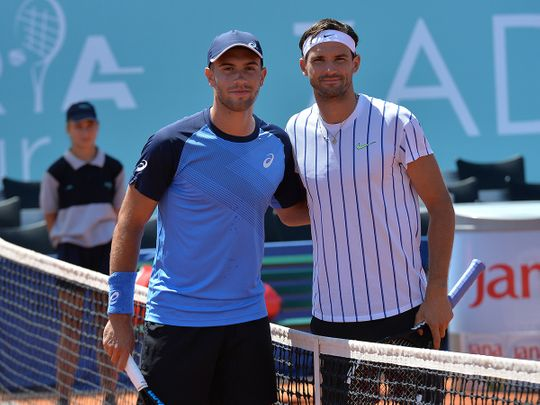 Bulgaria's Grigor Dimitrov, right, with Croatia's Borna Coric during their semifinal match at a tournament in Zadar, Croatia.