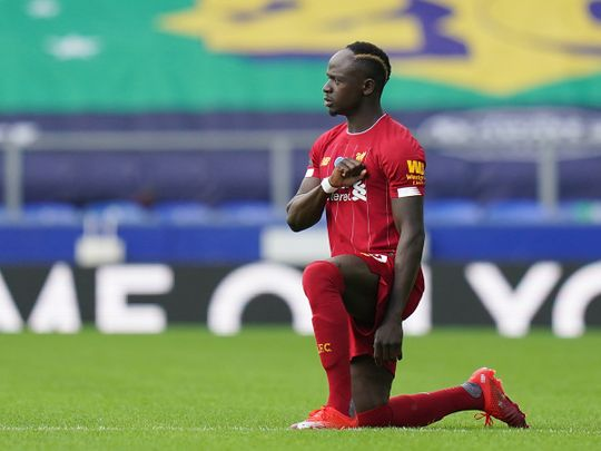 Liverpool's Sadio Mane finally takes a knee after his gaffe