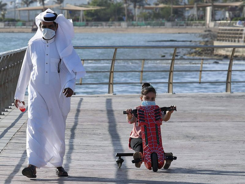 Saudi man with his daughter