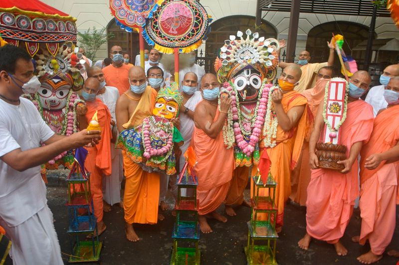 Temple priests and devotees carry idols of Hindu Gods, as a symbolic gesture after the Rath Yatra procession was cancelled amid concerns over the spread of the COVID-19 coronavirus, in Kolkata