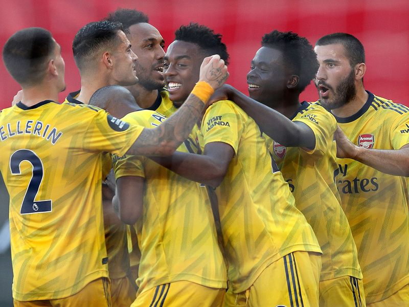Arsenal's English midfielder Joe Willock (C) is mobbed by teammates after scoring the second goal against Southampton.