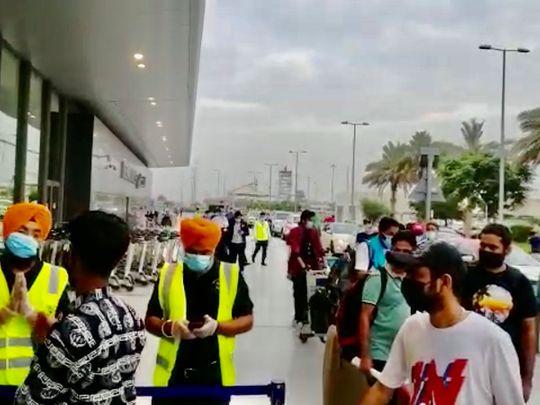 Passengers of the first repatriation flight to Punjab