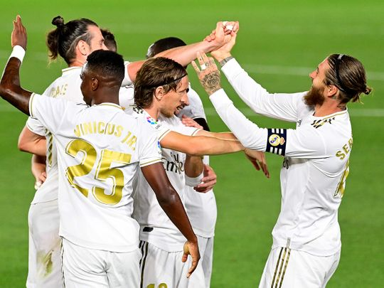Real Madrid's Sergio Ramos (R) celebrates with teammates after scoring against Mallorca