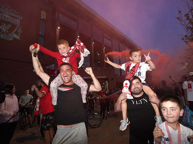 Liverpool fans celebrate winning the Premier League title