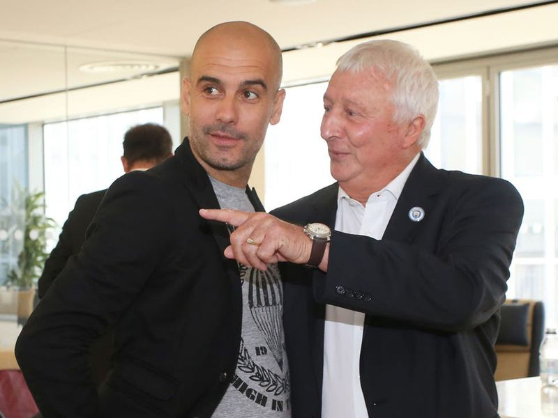 Mike Summerbee with Manchester City manager Pep Guardiola