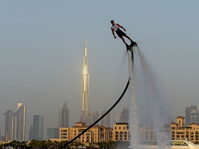 Participant competing in the flyboard competition during the Dubai Watersports Summer Week at Al Shorooq beach.