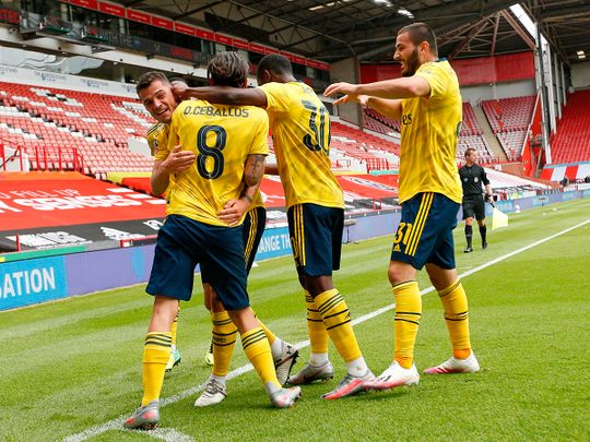 Arsenal celebrate the winner at Sheffield