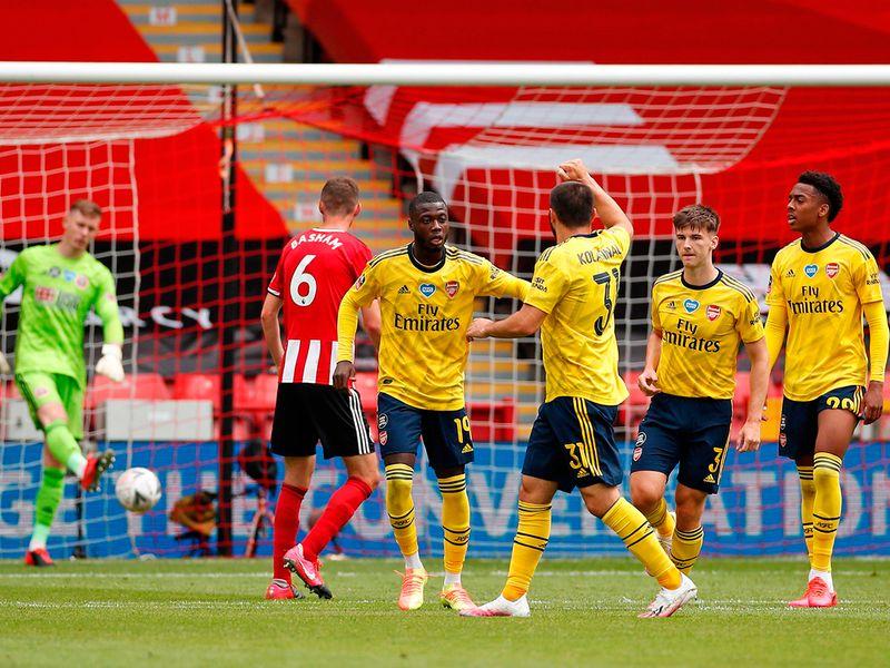 Arsenal's Pepe celebrates the opener against Sheffield