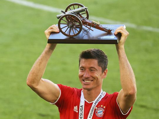 Bayern Munich's Robert Lewandowski celebrates with the Bundesliga top scorer trophy
