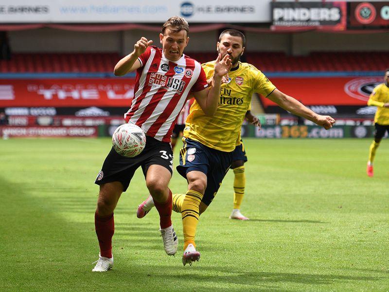Sander Berge in action with Arsenal's Sead Kolasinac