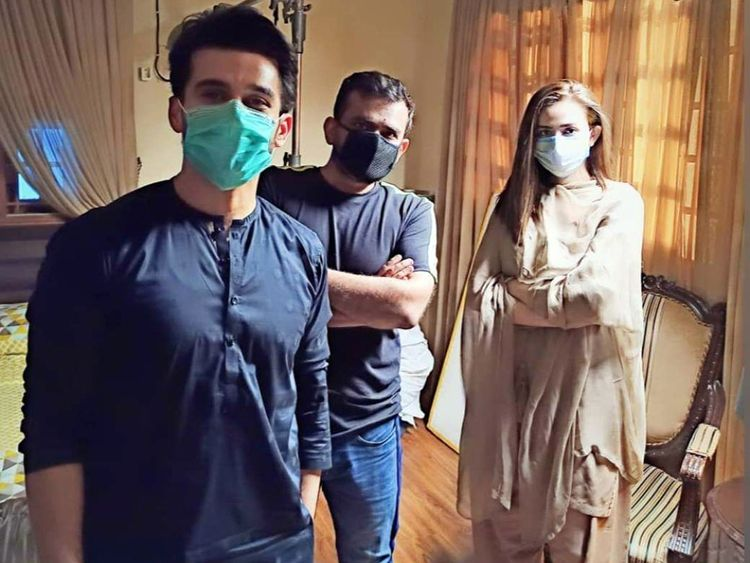 (L-R) Fahad Sheikh, director Badar Mehmood and Sana Javed on the set of DUNK-1593408410853