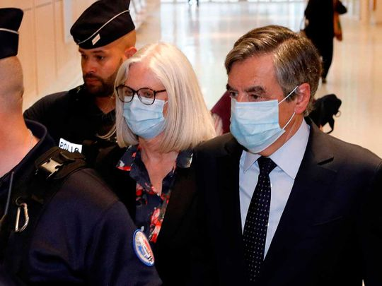 Former French Prime minister Francois Fillon (R) and his wife Penelope Fillon