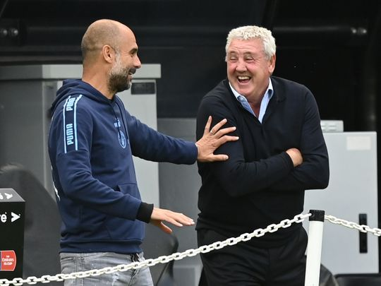 Manchester City's Pep Guardiola shares a joke with Newcastle's Steve Bruce