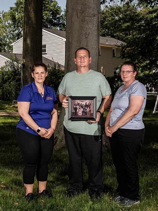 From left: siblings Elizabeth Fusco, Joe Fusco, and Maria Reid, at the Freehold, N.J., home of Joe Fusco, on June 9, 2020.