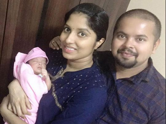 Jincy Antony with her husband and their newborn