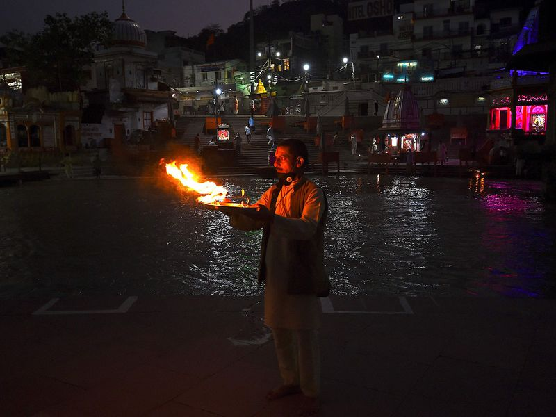 Pilgrims trickle back to the Ganges as India lockdown eases
