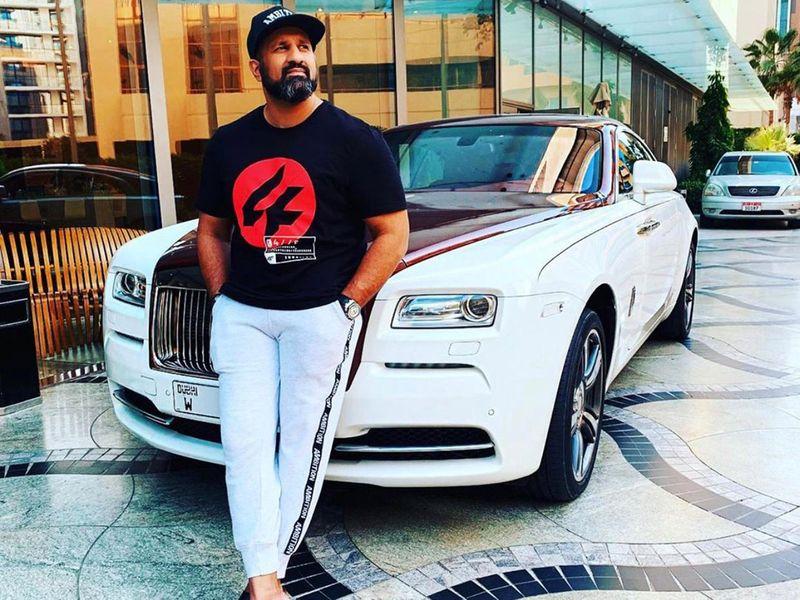 Com Mirza on a Rolls Royce