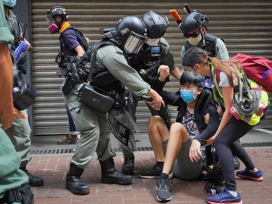 Hong Kong anniversary protest reporter police pepper spray