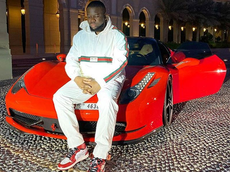 Hushpuppi on a Ferrari