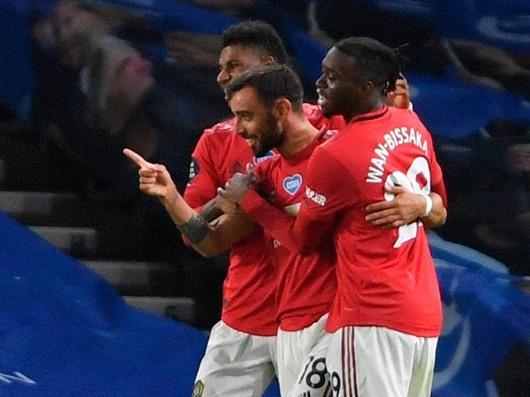 Manchester United's Bruno Fernandes (C) celebrates scoring their third goal against Brighton