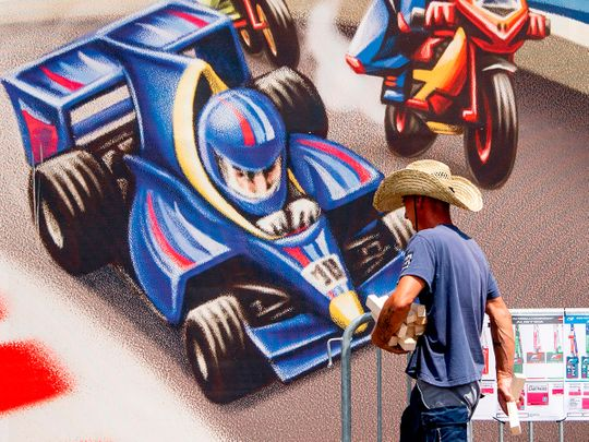 A worker with a cowboy hat at the Red Bull Ring ahead of the F1 season-opening Austrian Grand Prix in Spielberg