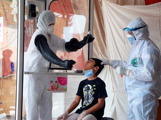 Nasal swab health workers pakistan