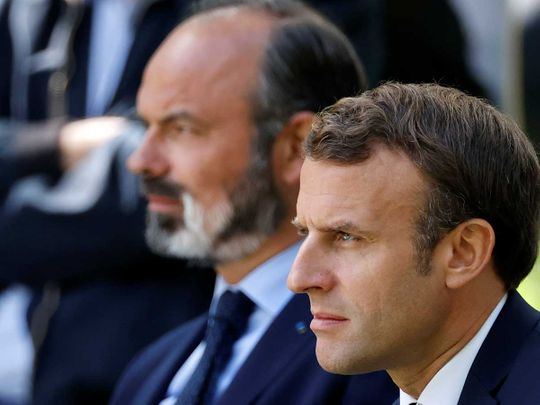 French President Emmanuel Macron (R) and French Prime Minister Edouard Philippe