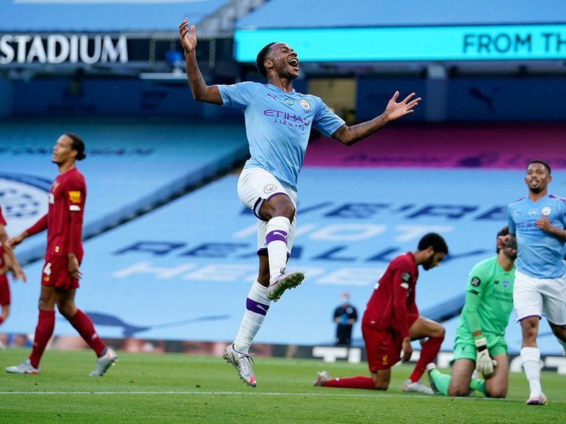 Raheem Sterling celebrates scoring against Liverpool