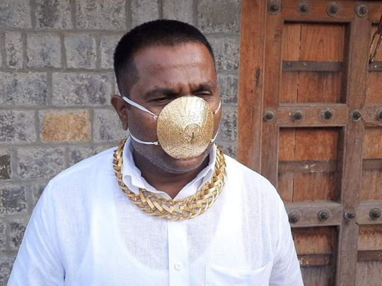 Pune man wears a gold mask