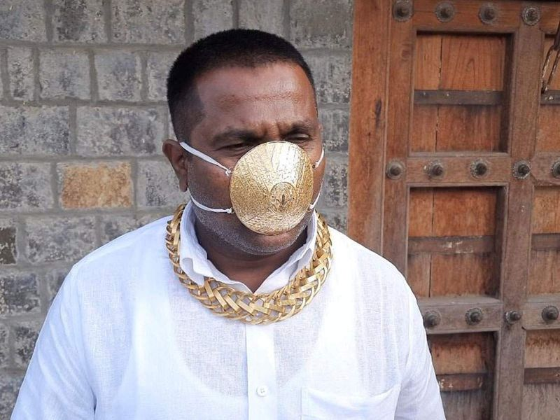 Pune man wears a gold mask