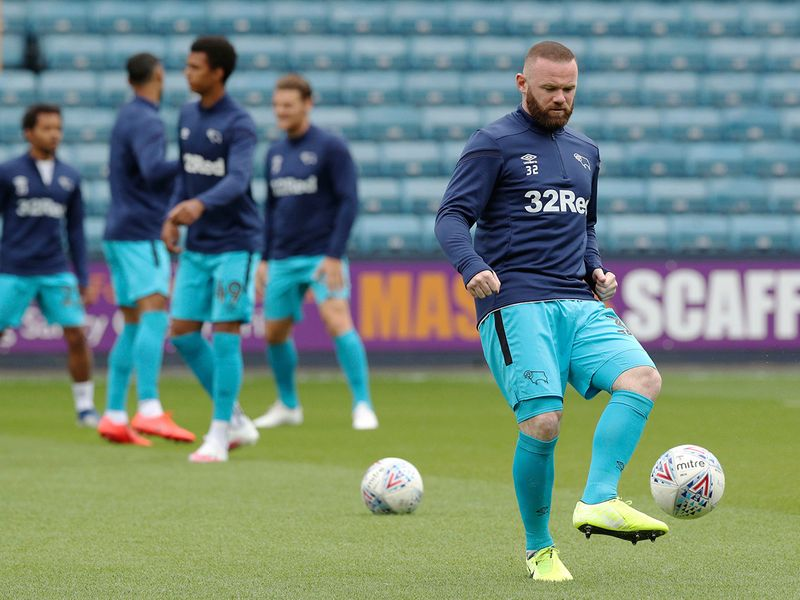 Wayne Rooney warms up for Derby