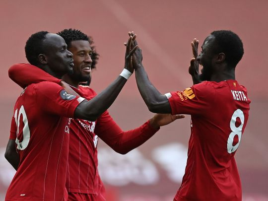 Liverpool's Sadio Mane celebrates scoring his team's first goal against Aston Villa