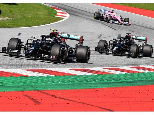 Mercedes' Finnish driver Valtteri Bottas leads Lewis Hamilton during the Austrian Grand Prix