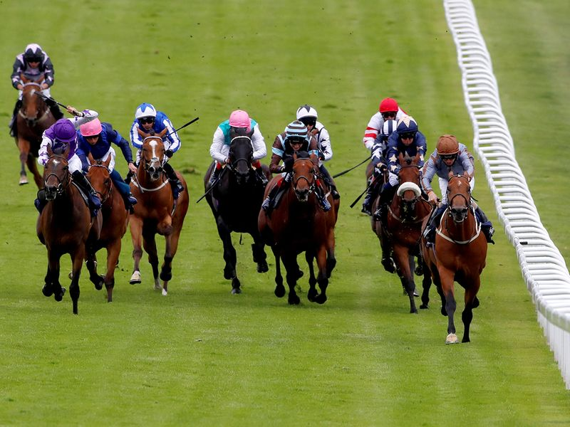 Race 3, Investec Handicap (1m 2f) - Sky Defender became the first long-odds winner on Derby Day with Joe riding a confident race aboard the 22/1 chance. Breath Caught ran on gamely for Harry Bentley to finish second.
