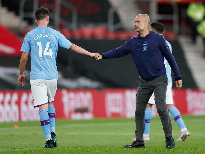 Manchester City's head coach Pep Guardiola with Aymeric Laporte.