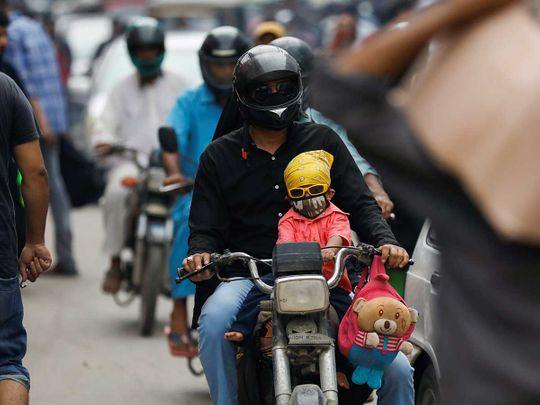 Karachi mask boy motorcycle Pakistan