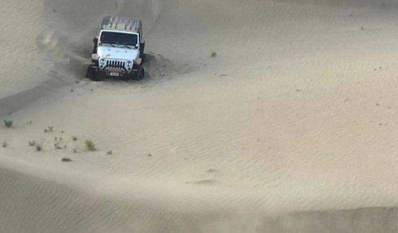SUV stuck in Abu Dhabi desert.