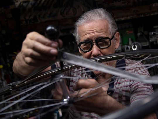 Elderly bicycle mechanic in Turin carries out impossible repairs
