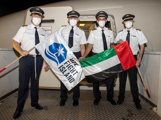 Etihad Airways flight crew pictured after landing at Abu Dhabi International Airport.