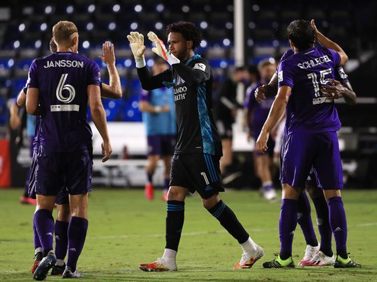 Pedro Gallese of Orlando City greets teammates after their victory over Inter Miami