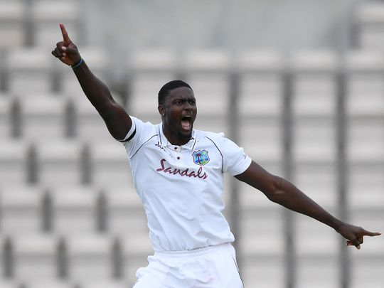 West Indies' Jason Holder celebrates taking the wicket of England's Ben Stokes in the first Test