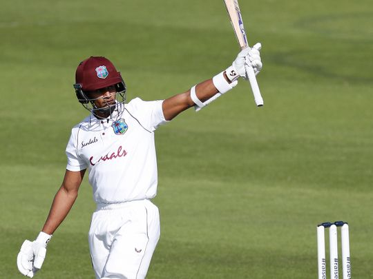 West Indies' Shane Dowrich raises his bat to celebrate scoring fifty against England