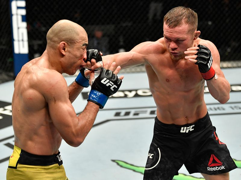 Petr Yan of Russia punches Jose Aldo of Brazil in their UFC bantamweight championship fight during the UFC 251 event at Flash Forum on UFC Fight Island on July 12, 2020 on Yas Island