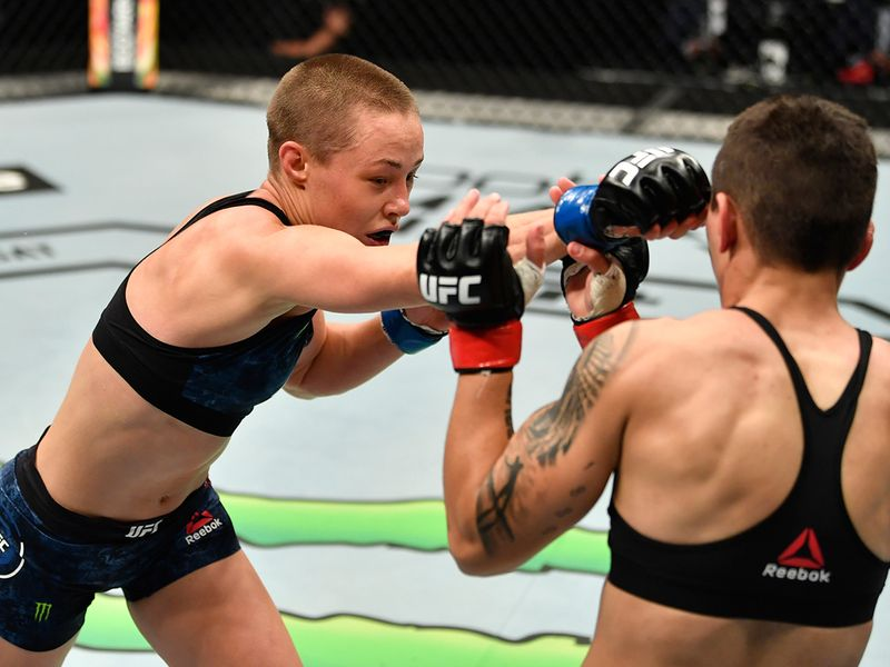 Rose Namajunas punches Jessica Andrade of Brazil in their strawweight fight during the UFC 251 event at Flash Forum on UFC Fight Island on July 12, 2020 on Yas Island, Abu Dhabi,