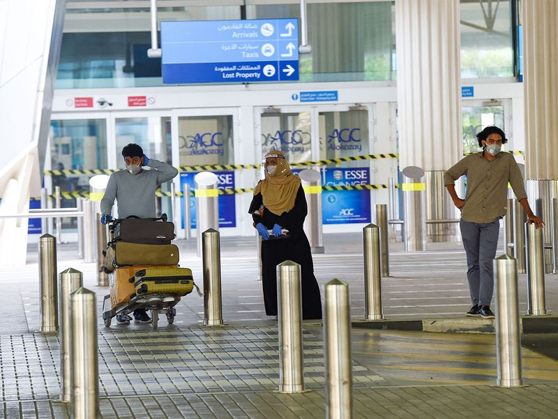 Arrivals at Dubai Airport on Sunday as first flights from India since March 19 arrive