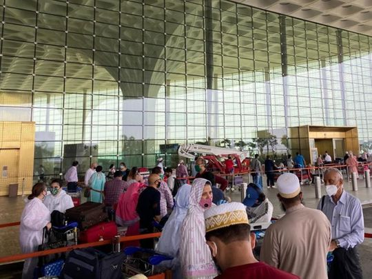 Indian expats leave Mumbai airport bound for UAE