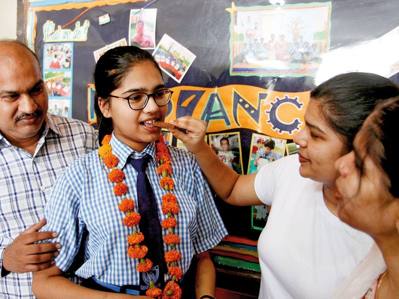 Divyanshi Jain, all India topper of CBSE 12th standard who secured 100% marks celebrates her performance with her family