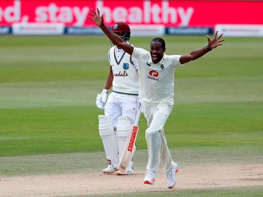 England's Jofra Archer celebrates after trapping West Indies' Shamarh Brooks leg before wicket.